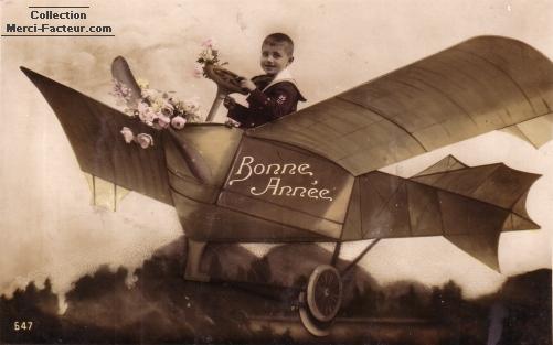 Carte de voeux avec aéroplane et enfant avec roses